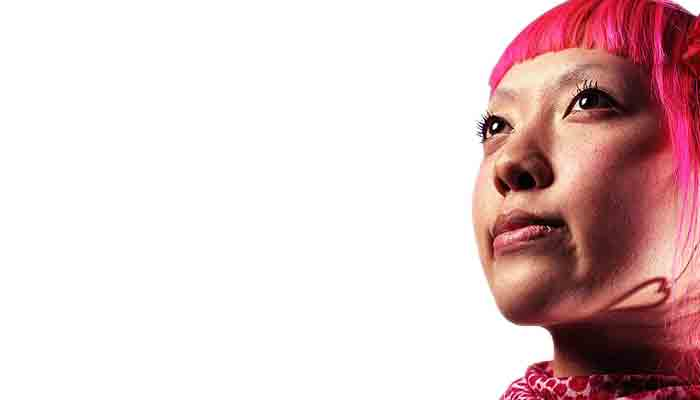 Close-up of an Asian woman with pink hair